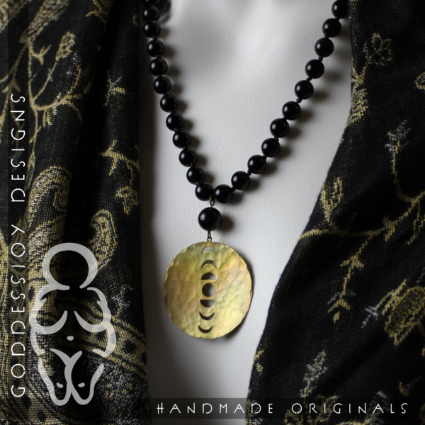 """New Moon Necklace - 1.5"""" Round Brass Moon Phase pendant hanging from a knotted strand of 8mm black obsidian beads"""